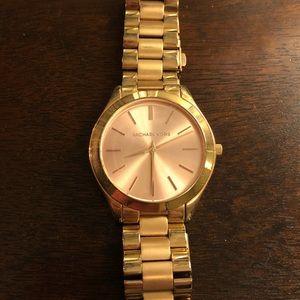 Slightly used mini slim runway rose gold watch!